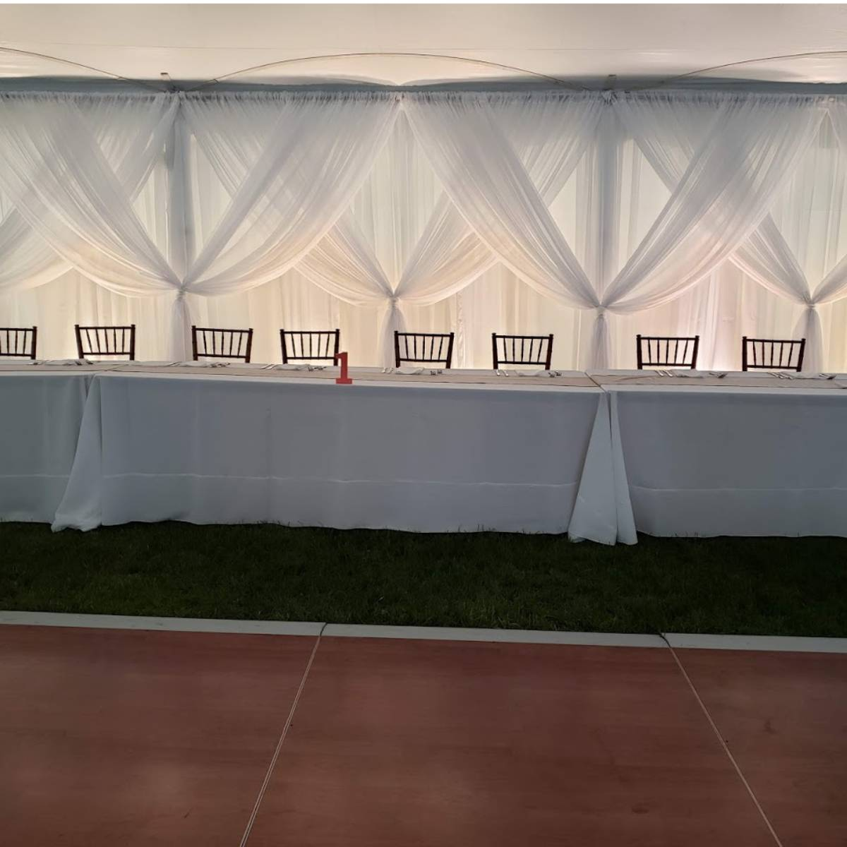 Sheer White Backdrop With Sheer White Front Layer Crisscrossed With Uplights